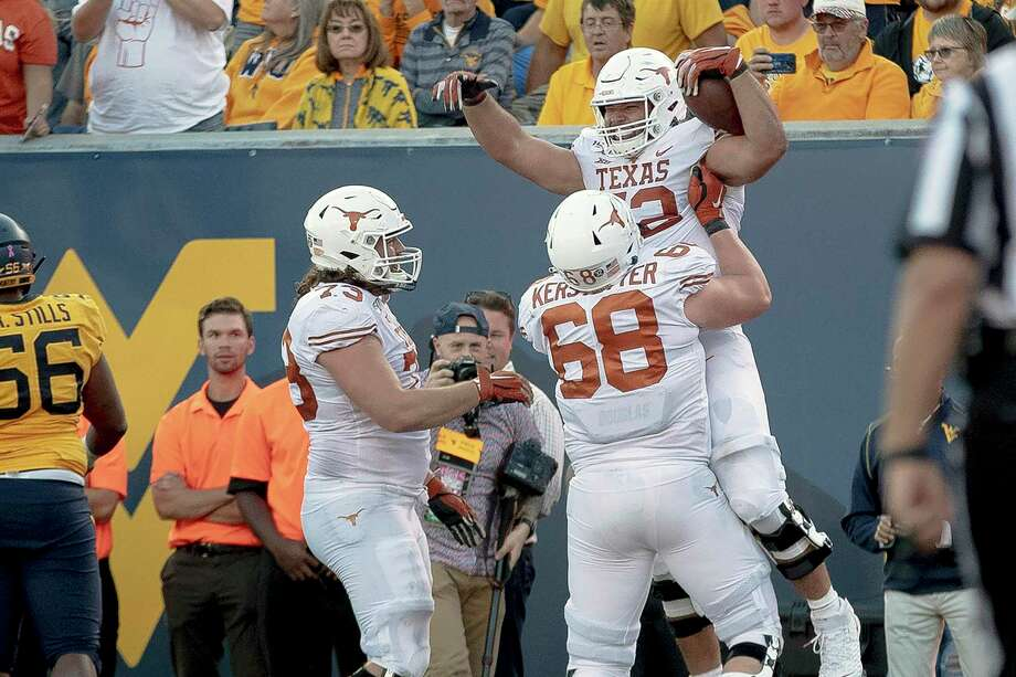 FILE - In this Oct. 5, 2019, file photo, Texas offensive lineman Samuel Cosmi (52) celebrates a touchdown against West Virginia during an NCAA college football game in Morgantown, W. Va. Cosmi lived every offensive lineman's dream when he caught a lateral from Sam Ehlinger and rumbled 12 yards for a touchdown in a 42-31 win over West Virginia. (Nick Wagner/Austin American-Statesman via AP, File) Photo: Nick Wagner, MBO / Associated Press / Austin American-Statesman