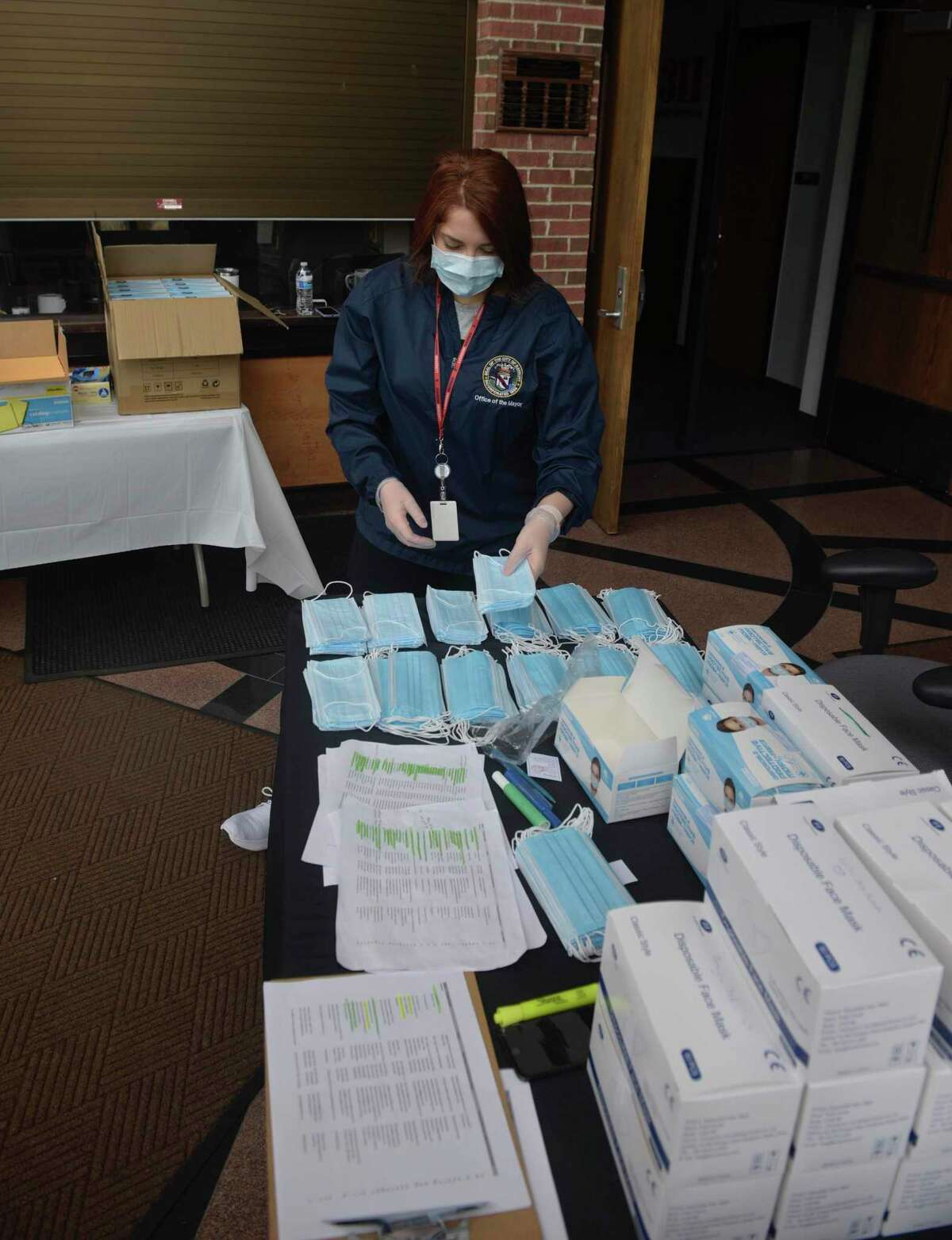 Taylor O'Brien, public relations co-ordinator, counts out face at city hall. As of around 3:30 p.m. Friday, O'Brien was in the lead with $1,930 raised. Boughton collected $1,465. Community members and local banks have donated about $67,850 total to feed Danbury area families for the holidays. The goal is to raise at least $100,000.