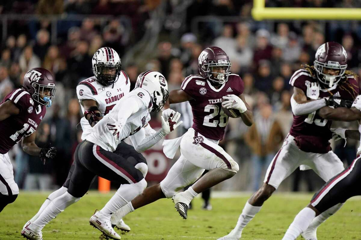 Texas A&M running back Isaiah Spiller (28) rushes against South Carolina during the second quarter of an NCAA college football game Saturday, Nov. 16, 2019, in College Station, Texas. (AP Photo/David J. Phillip)