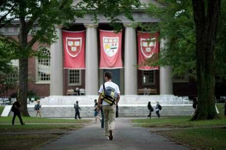 Harvard University students on campus in Cambridge, Mass