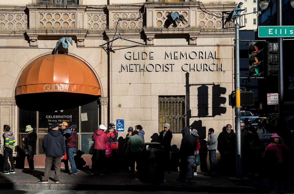People wait in line outside of Glide Memorial Church in San Francisco, Calif. Tuesday, Dec. 25, 2018 to receive a free holiday meal. Glide reached a settlement to part ways with the Methodist Church.