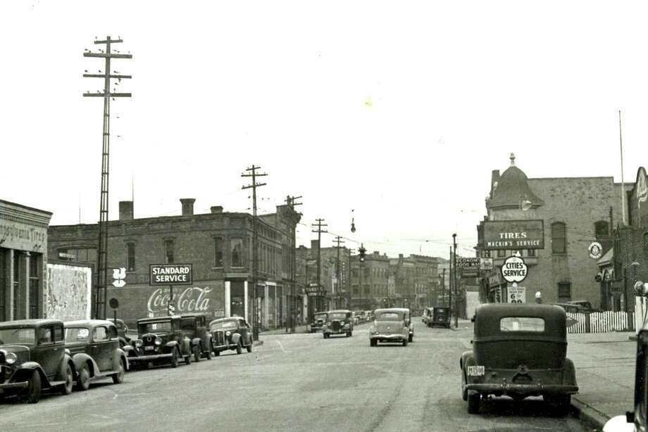 This photo shows a view looking west down River Street near Cypress Street circa 1938. (Manistee County Historical Museum photo)
