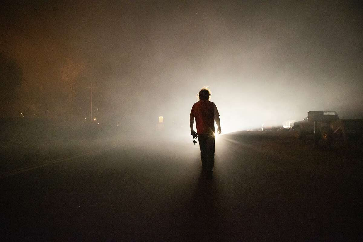 Tom Smith walks on Platina Road in Shasta County after refusing to evacuate from the Zogg Fire in September. Four died in the fire.