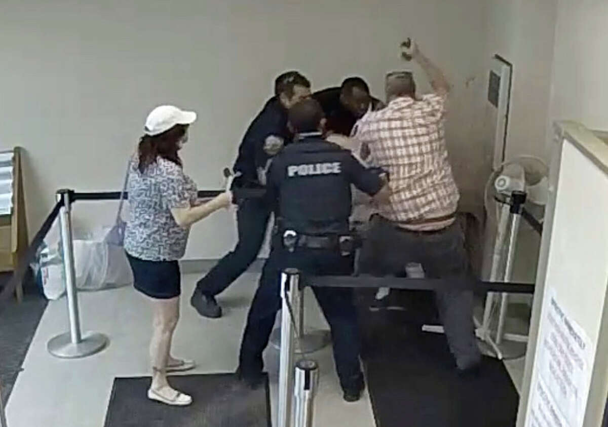 Frame grab from security camera footage shows Jason Daigneault of Schenectady being taken down hit with radio by police officers after he became frustrated after being asked to wear a mask before entering the Schenectady County Social Services building during a visit this summer with his mother, Cheryl, left.
