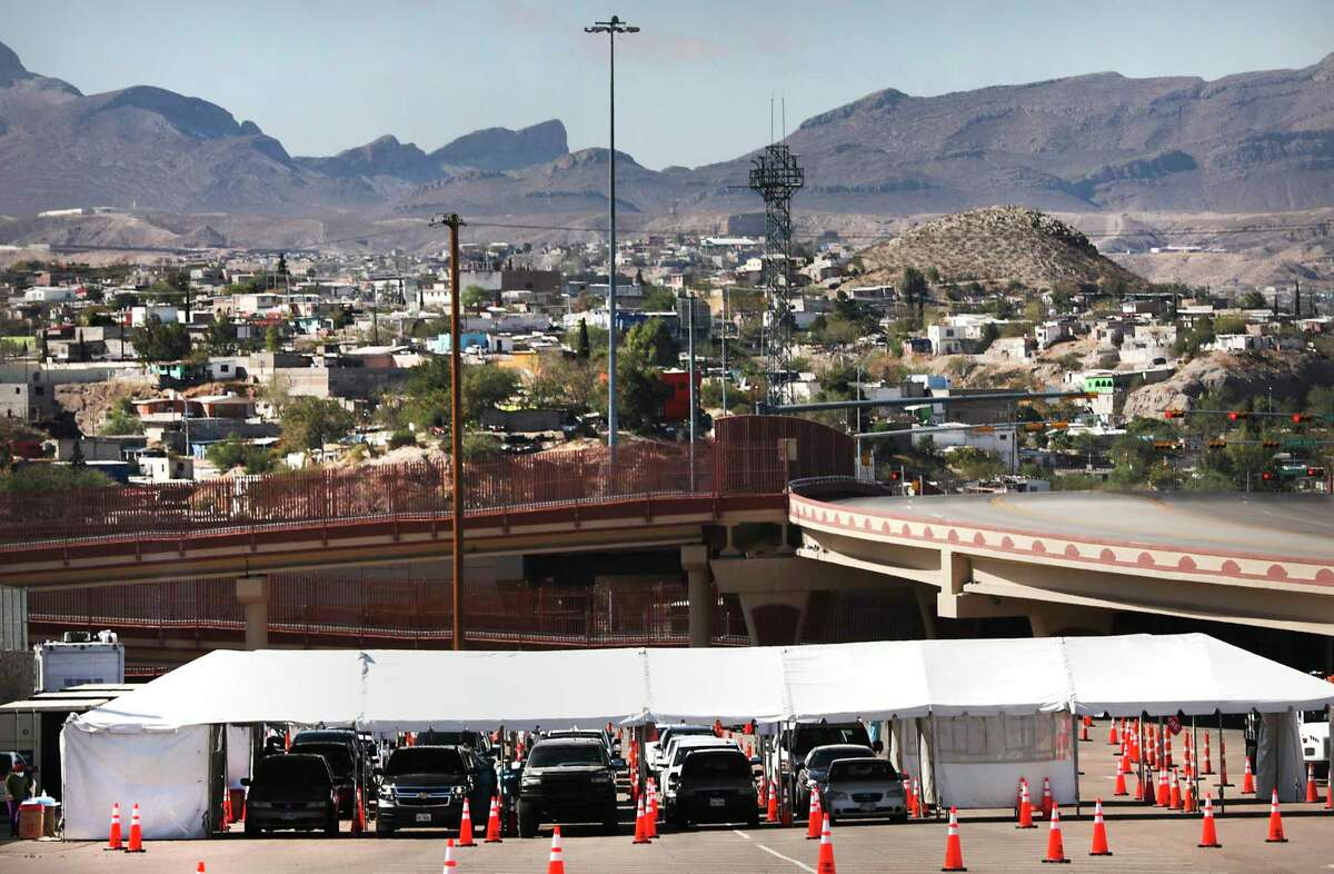 Vehicles line up in a parking lot near the University of Texas at El Paso for coronavirus testing offered by the state on Oct. 29.