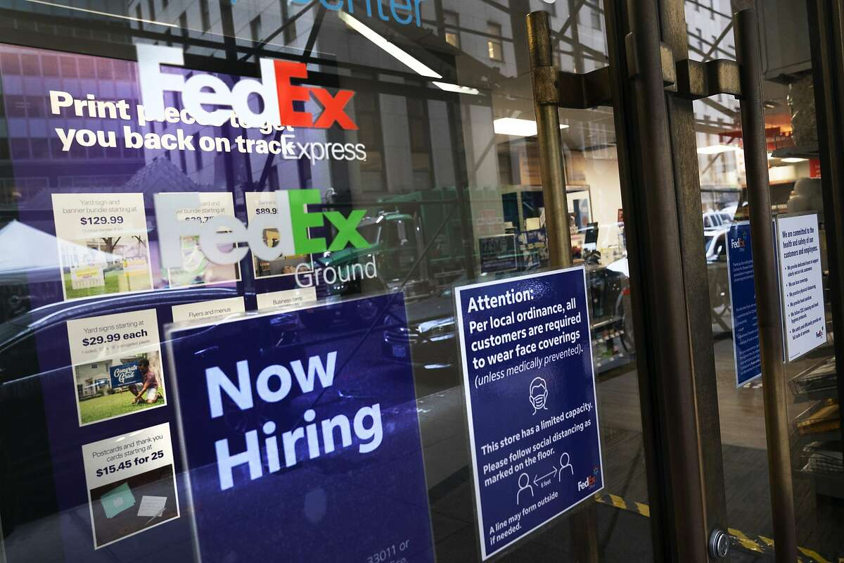 """A sign in the window of a FedEx office in New York this month reads, """"Now Hiring."""""""