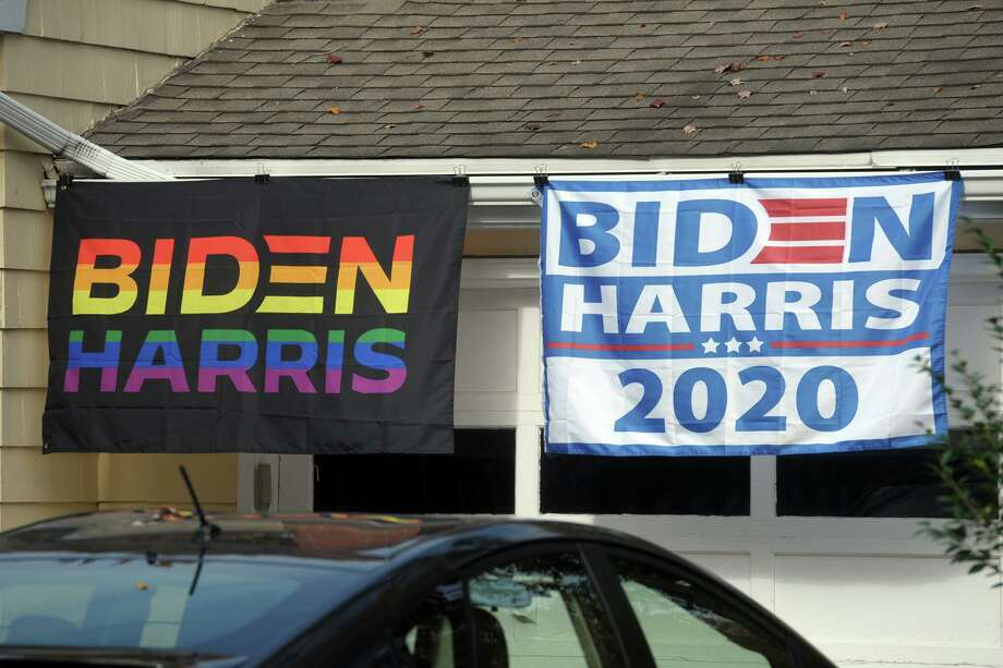 Bidden/Harris 2020 presidential election banners hang in front of a home in Milford, Conn., Oct. 21, 2020. Photo: Ned Gerard / Hearst Connecticut Media / Connecticut Post