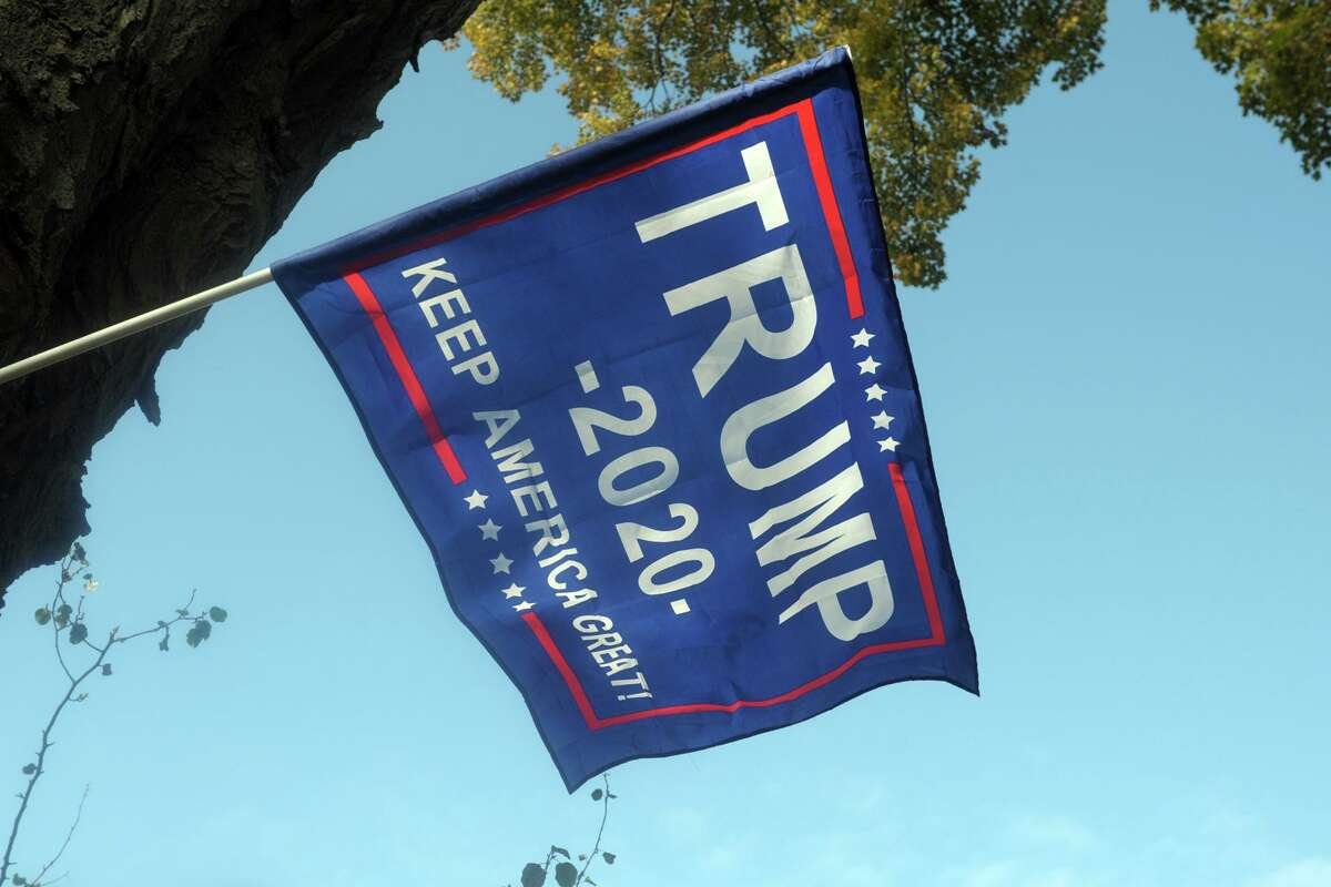A President Trump 2020 flag flies in front of a home in Milford, Conn., Oct. 21, 2020.