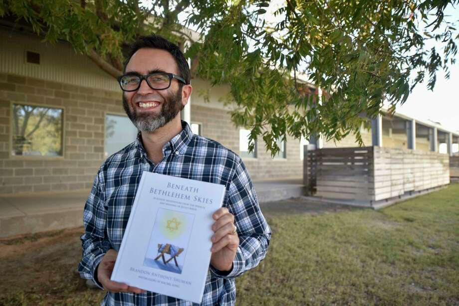 """Brandon Shuman poses with """"Beneath Bethlehem Skies: 26 Advent Meditations Upon the Miracle and Meaning of Jesus's Birth"""" on Thursday, Nov. 5, 2020 at Midland Classical Academy.     Jacy Lewis/Reporter-Telegram Photo: Jacy Lewis/Reporter-Telegram"""