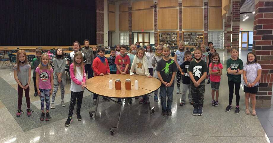 Onekama Consolidated Schools third and fourth grade students were treated to a pancake lunch on Friday. The syrup was made last spring as part of a project by teacher Ben Mauntler's second grade class. Photo: Courtesy Photo