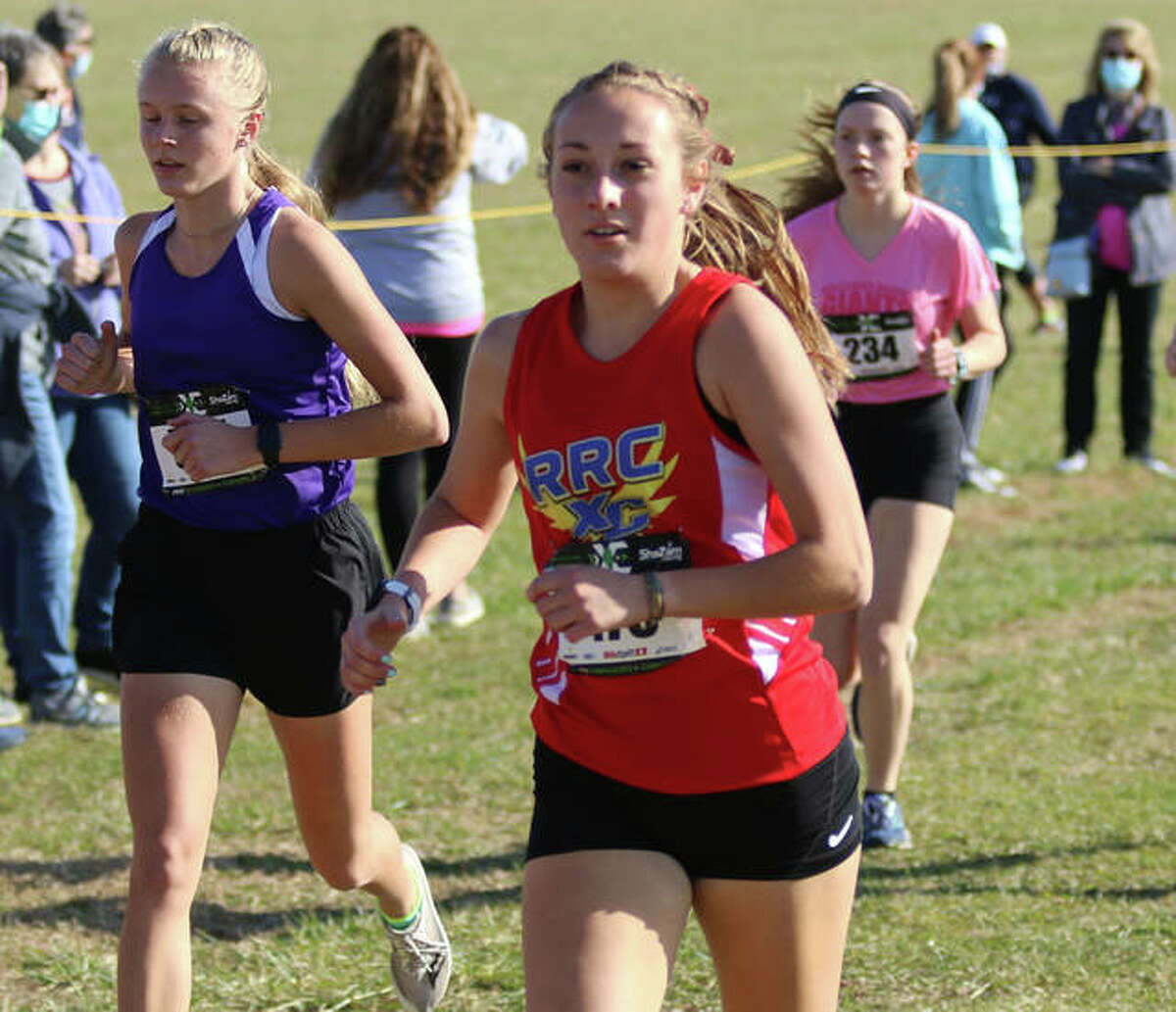 Roxana's Janelynn Wirth (middle) runs in the opening mile of the ShaZam Championships on Friday at Three Sisters Park in Chillicothe.