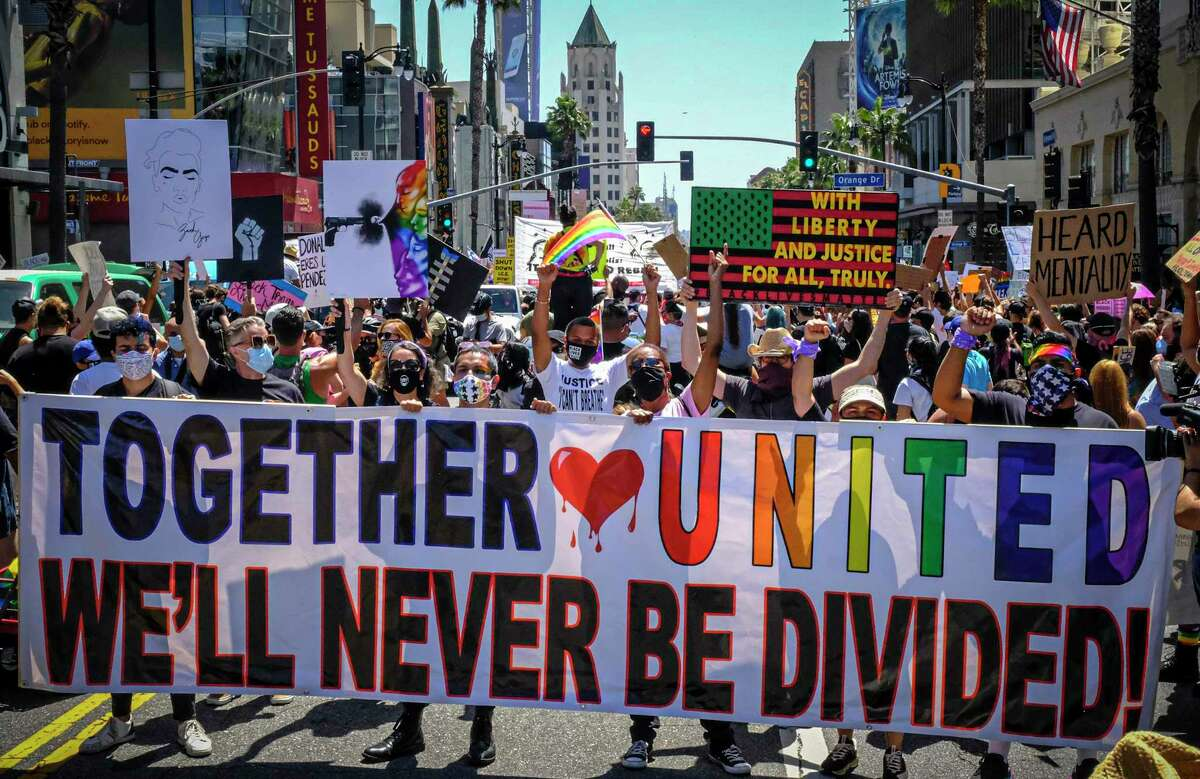"""Protesters call for unity June 14 in Los Angeles. The author notes """"our society relies upon our unity as Americans."""""""