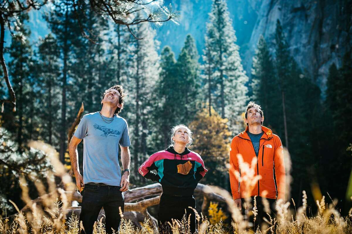 Left to right: Climbers Adrian Ballinger, Emily Harrington and Alex Honnold stand in Yosemite Valley and look up at El Capitan in November 2020.