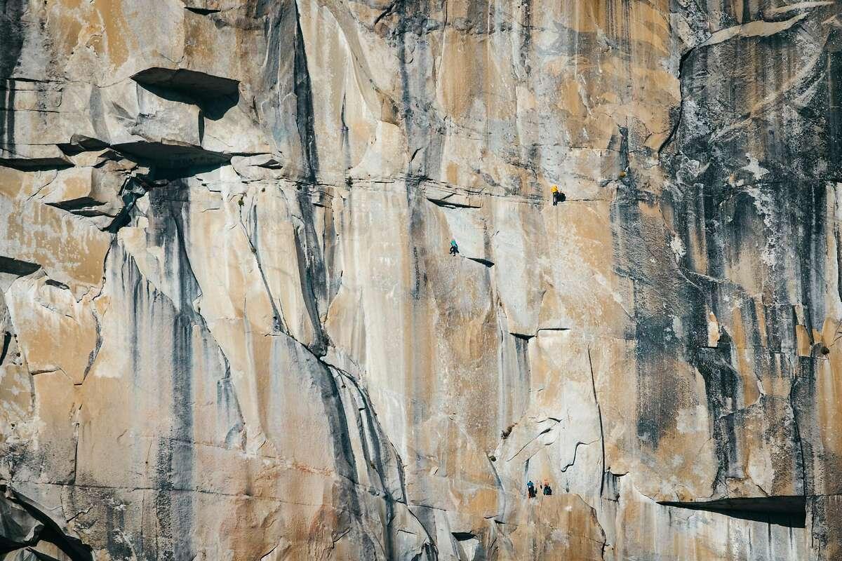 Climber Emily Harrington (center, blue jacket) ascends El Capitan in November 2020.