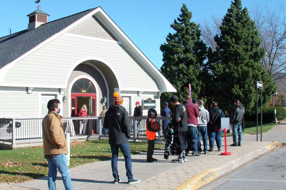Manistee voters wait in line during the Nov. 3 presidential election. Local election officials report being inundated with calls from people demanding to know if their votes had been counted. (File Photo)