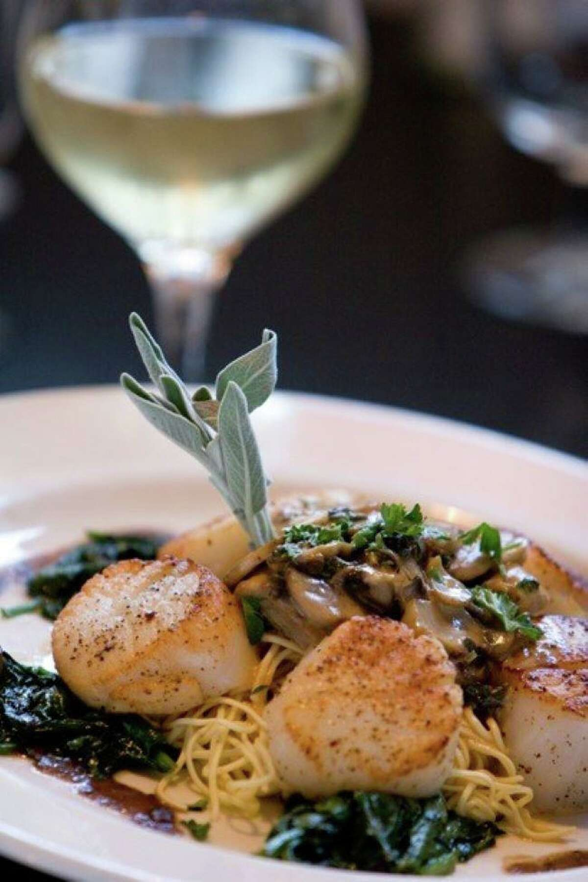 Two Steps Downtown Grille in Danbury is presenting a return to Ciao! Cafe. For a limited time, it will recreate items from its restaurant that was a Danbury landmark for two decades. Fresh Sea Scallops - over angel hair with mushrooms in a madeira cream sauce, is seen here.