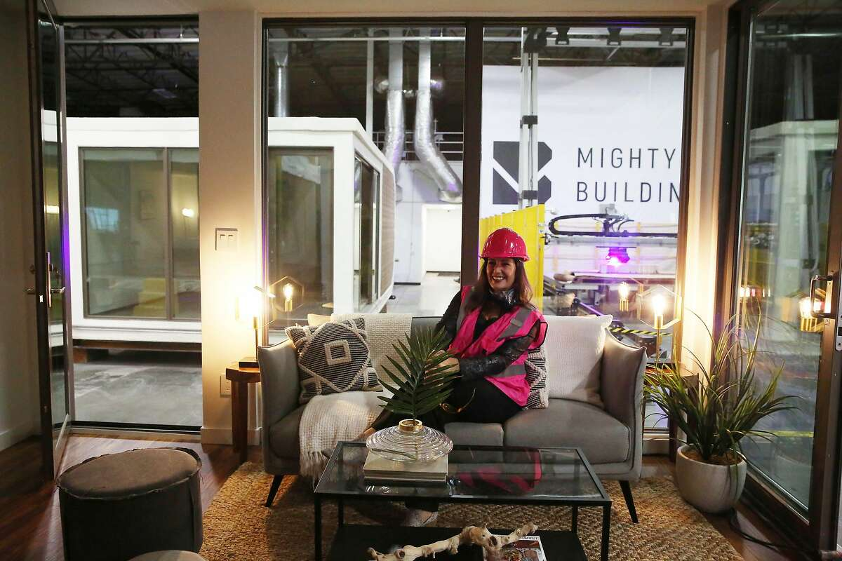 Oakland Mayor Libby Schaaf takes a seat on the couch during a tour a Mighty Duo B at Mighty Buildings on Friday, November 6, 2020 in Oakland, Calif.