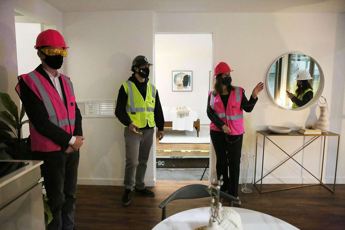Oakland Mayor Libby Schaaf (right) and Darin Ranelletti (left), policy director for housing security, tour a Mighty Duo B with Zayn El Hajji (center), projext manager, at Mighty Buildings on Friday, November 6, 2020 in Oakland, Calif.