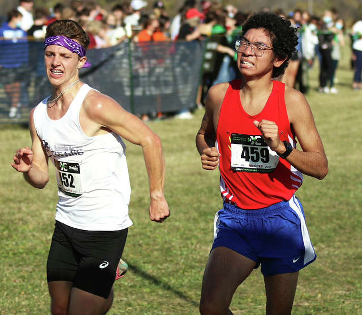 Roxana's Carlos Ruvalcaba (right) is passed just before the finish line by El Paso-Gridley's Nathan DeMarb on Friday afternoon in the ShaZam Racing 2020 High School XC Championships at Three Sisters Park in Chillicothe.