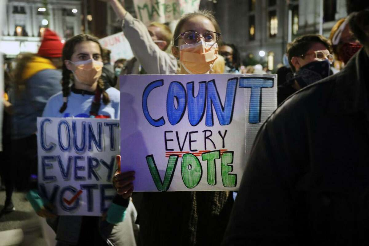People participate in a protest in support of counting all votes as the election in Pennsylvania is still unresolved on Nov. 4, 2020 in Philadelphia, Pennsylvania. With no winner declared in the presidential election so far, all eyes are on the outcome in a few remaining swing states to determine whether Donald Trump will get another four years or Joe Biden will become the next president of the United States.