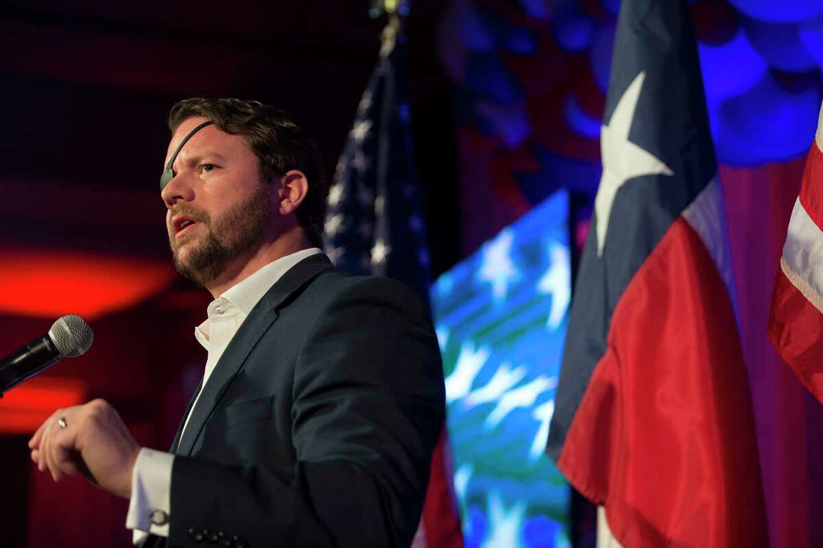 Republican congressman Dan Crenshaw speaks to his supporters as he celebrates his victory during an election watch party Tuesday, Nov. 3, 2020 in Houston.