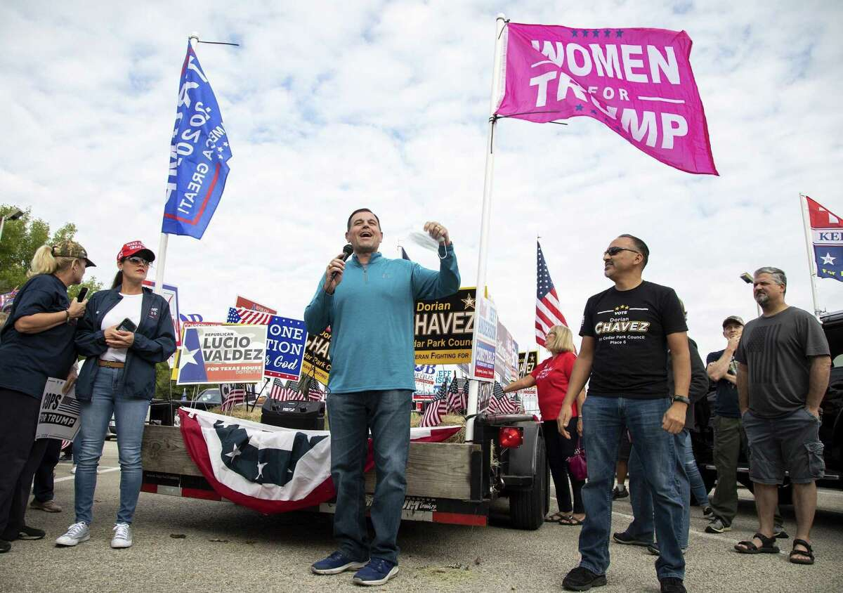 Mike Guevara, a GOP candidate for Texas House in Williamson County, speaks during an Oct. 24 car rally in support of President Donald Trump in Cedar Park. (Ana Ramirez/Austin American-Statesman/TNS)