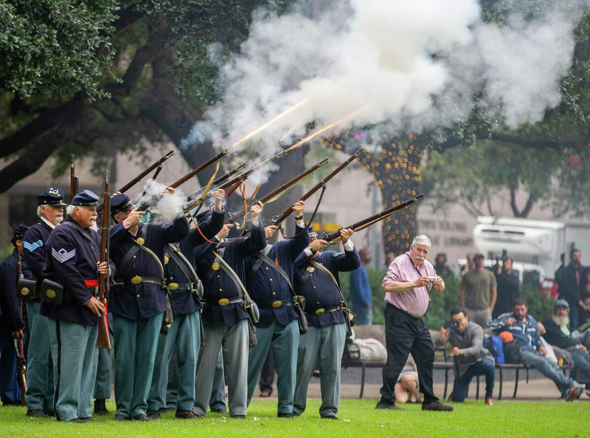Reenactors fire a 21-gun salute at the conclusion of the Houston Salutes American Heroes Veterans Day ceremony at City Hall in downtown Houston, Monday, Nov. 11, 2019.