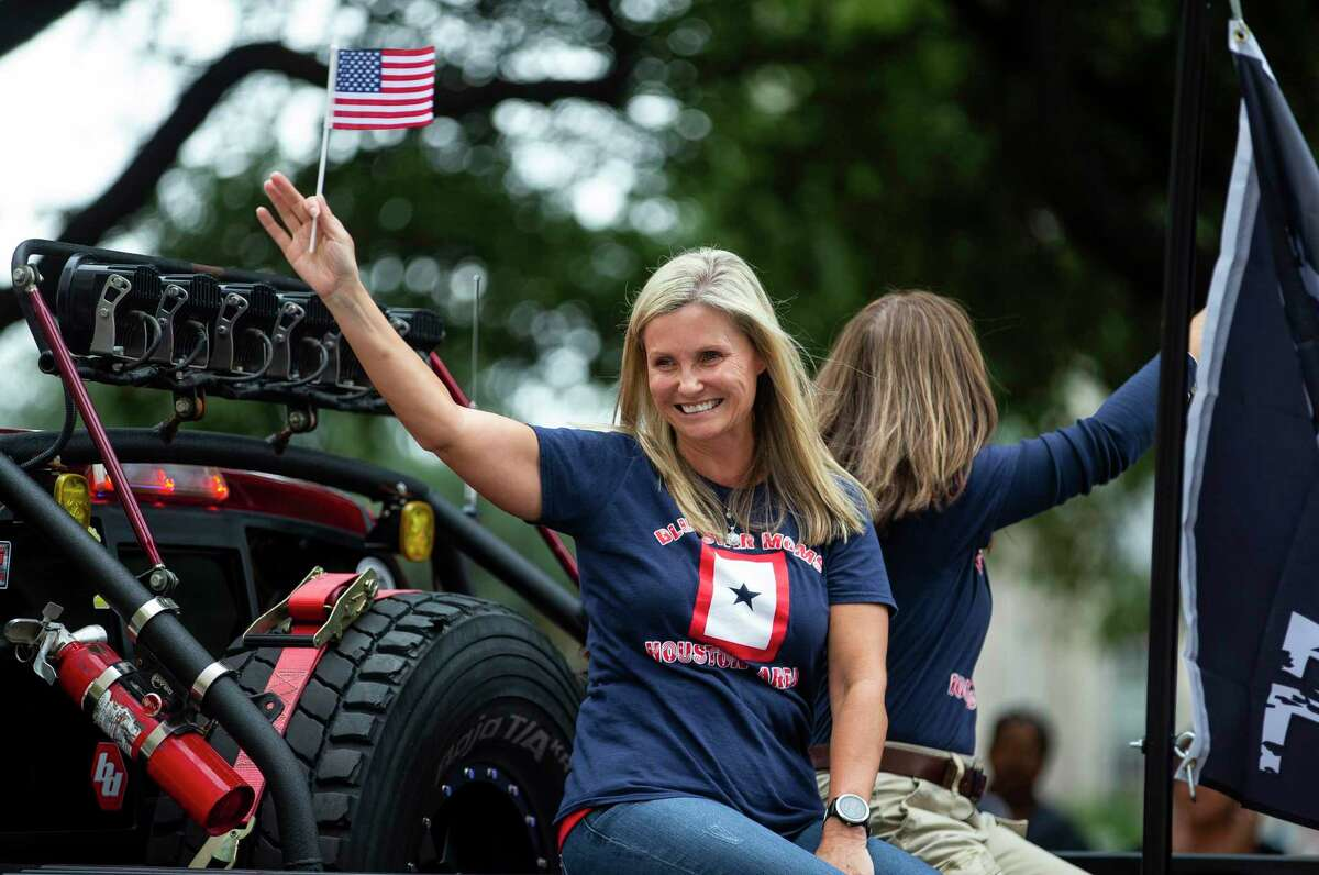 Blue Star Moms wave from a truck during the Houston Salutes American Heroes Veterans Day parade in downtown Houston, Monday, Nov. 11, 2019.