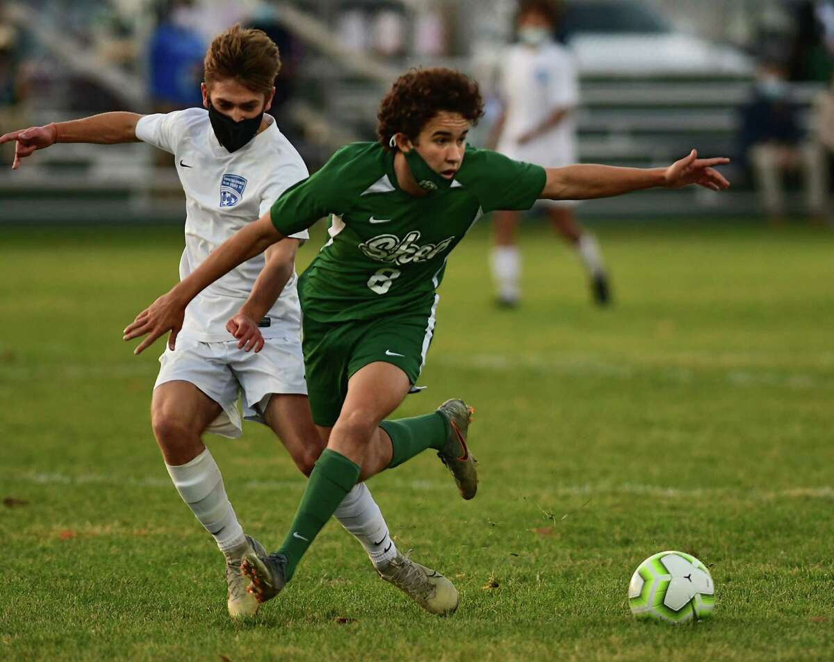 Saratoga's Evan Hallett, left, battles with Shenendehowa's Zak Smith during a soccer game on Friday, Nov. 6, 2020 in Clifton Park, N.Y. (Lori Van Buren/Times Union)