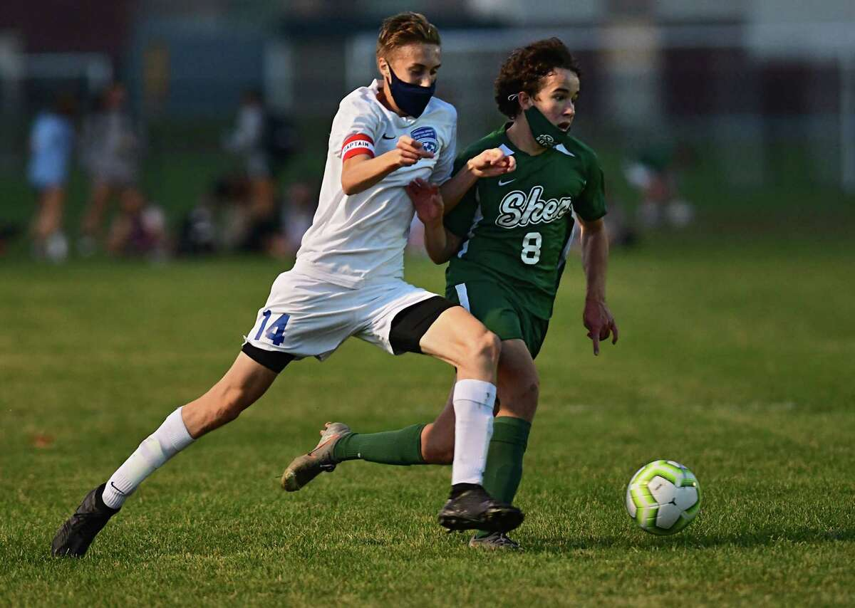 Saratoga's Zach Colangelo, left, battles with Shenendehowa's Zak Smith during a soccer game on Friday, Nov. 6, 2020 in Clifton Park, N.Y. (Lori Van Buren/Times Union)