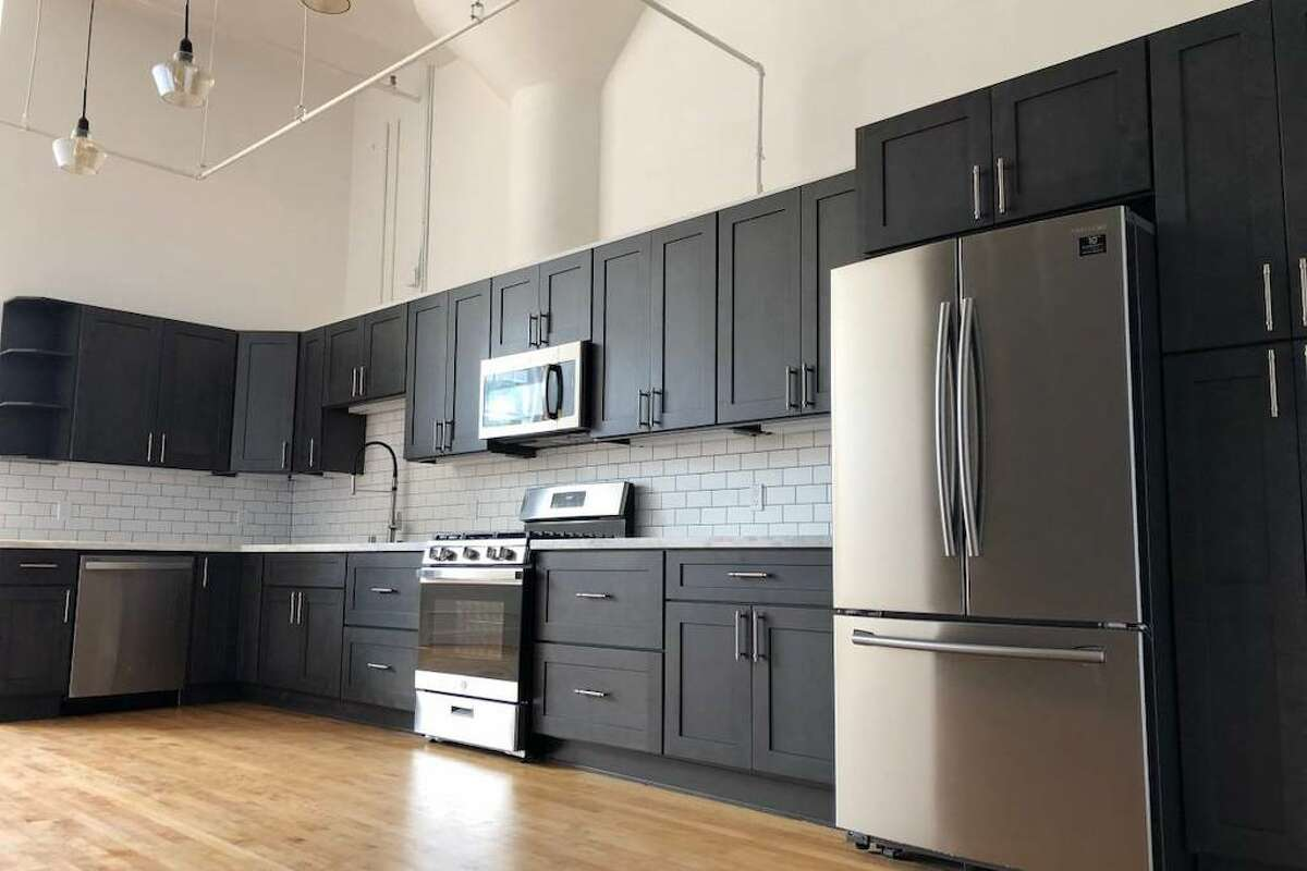 Renovations include a huge new kitchen with stainless steel appliances and pantry storage.