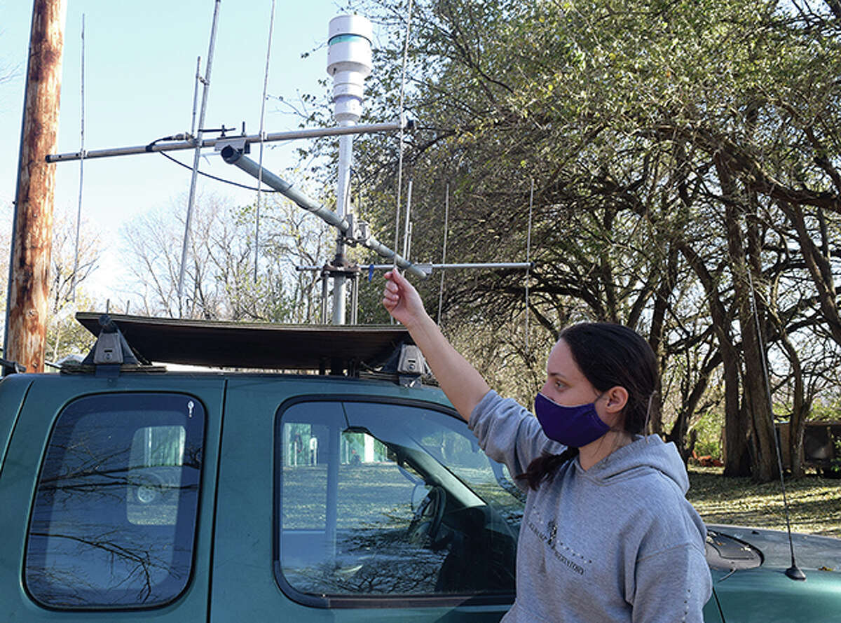 Fournier shows off one of the trucks, complete with antenna, that trackers to use to find ducks that have had a transmitter placed on them.
