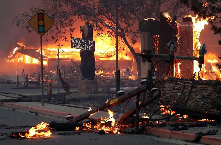 Businesses burn as the Camp Fire destroys a large portion of the Butte County community of Paradise in November 2018. Photo: Scott Strazzante / The Chronicle