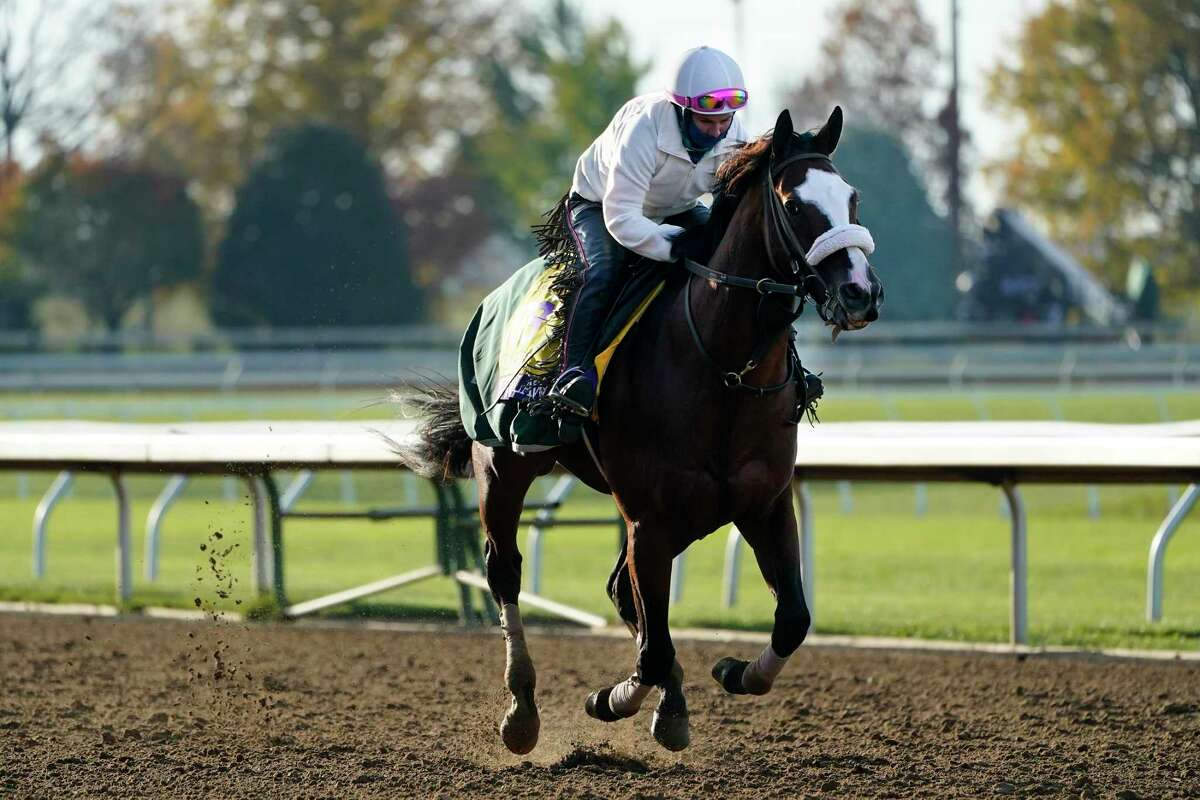 Belmont Stakes winner Tiz the Law is taken for a workout at the Breeders' Cup World Championship horse races at Keeneland Race Course Thursday, Nov. 5, 2020, in Lexington, Ky. Tiz the Law is scheduled to run in the Breeders' Cup Classic race Saturday.