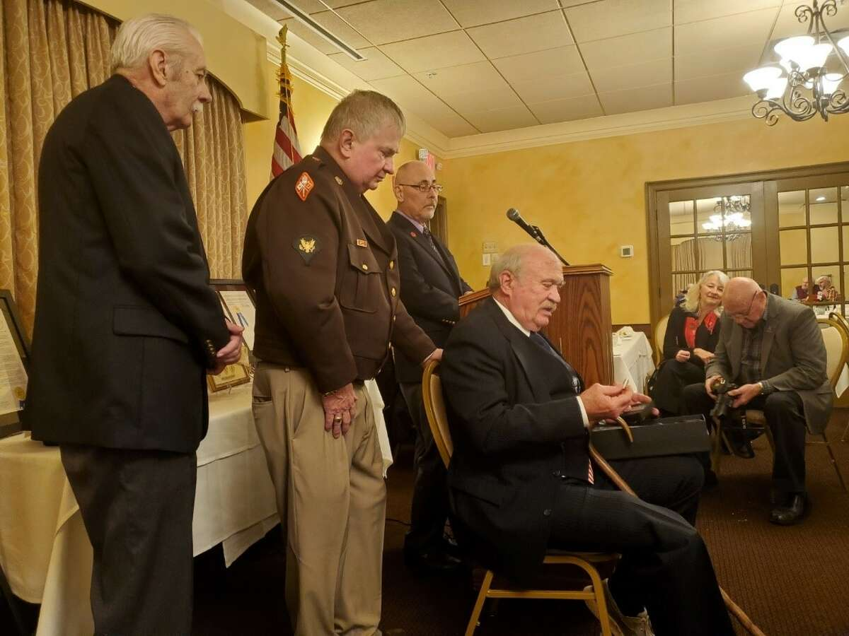 John Mullen, second from left, co-chairman of the Rev. Francis Kelley Society, congratulates former Army Staff Sgt. Raymond Chip Lynch, seated, after the Vietnam veteran received a Hometown Hero Award.(Courtesy Ray Paulson)