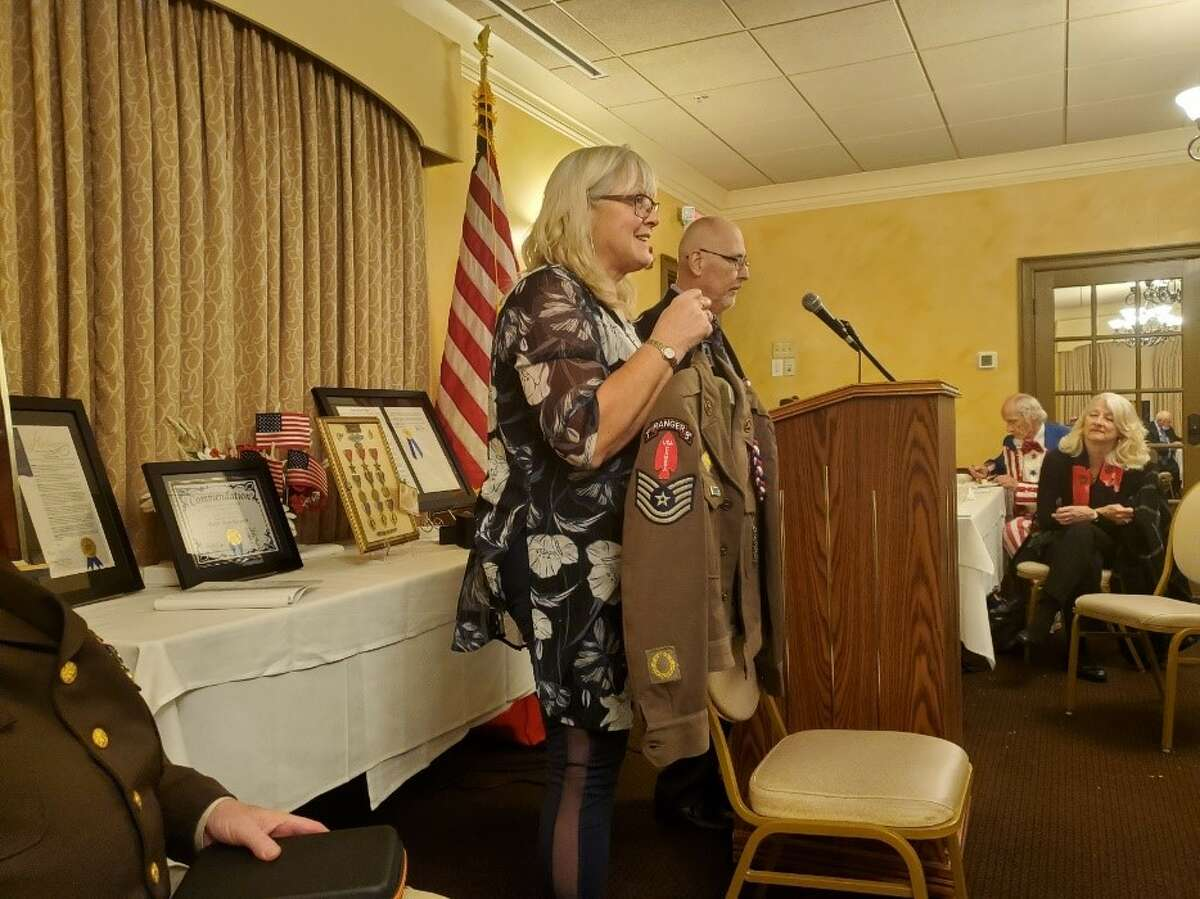 Lois Rybka of Ghent displays a uniform similar to what her dad, the late former Tech Sgt. Andrew Rybka wore.(Courtesy Ray Paulson)