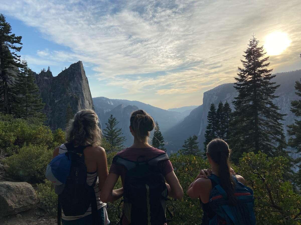 Balanced Rock participants gaze out at Yosemite National Park.