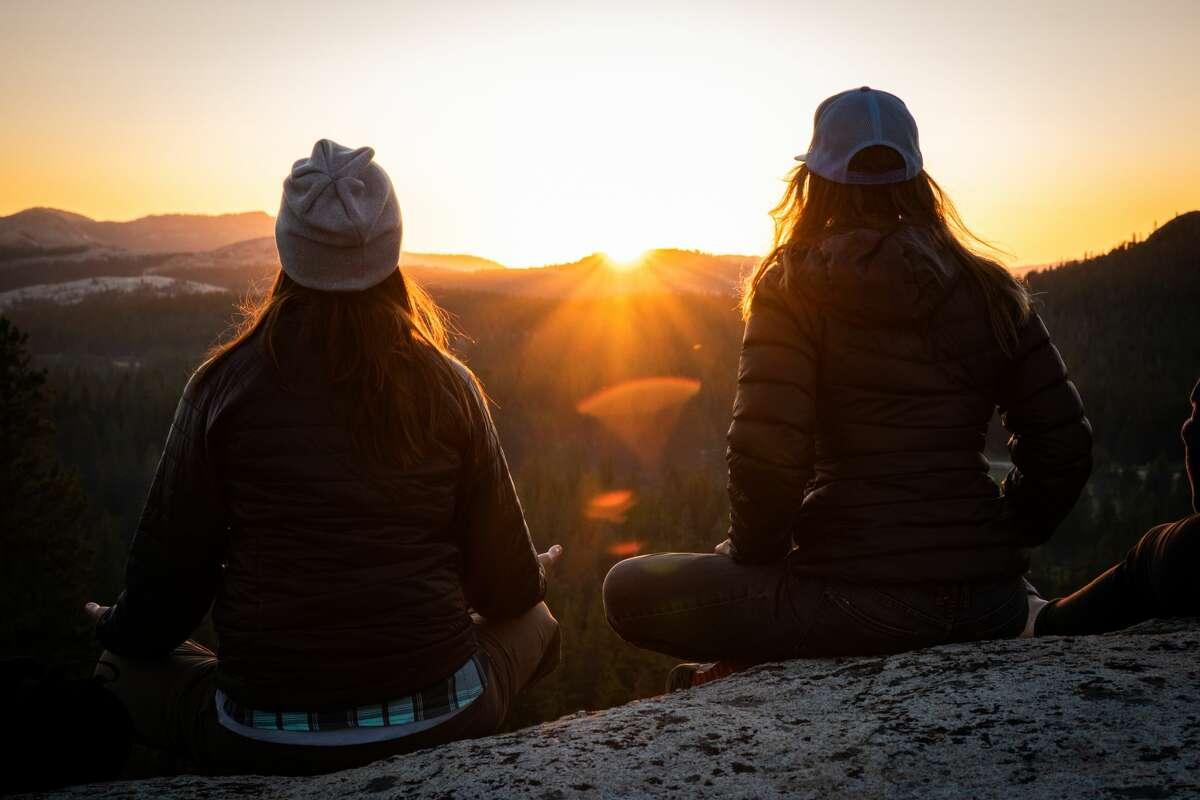 Balanced Rock women behold a sunset.