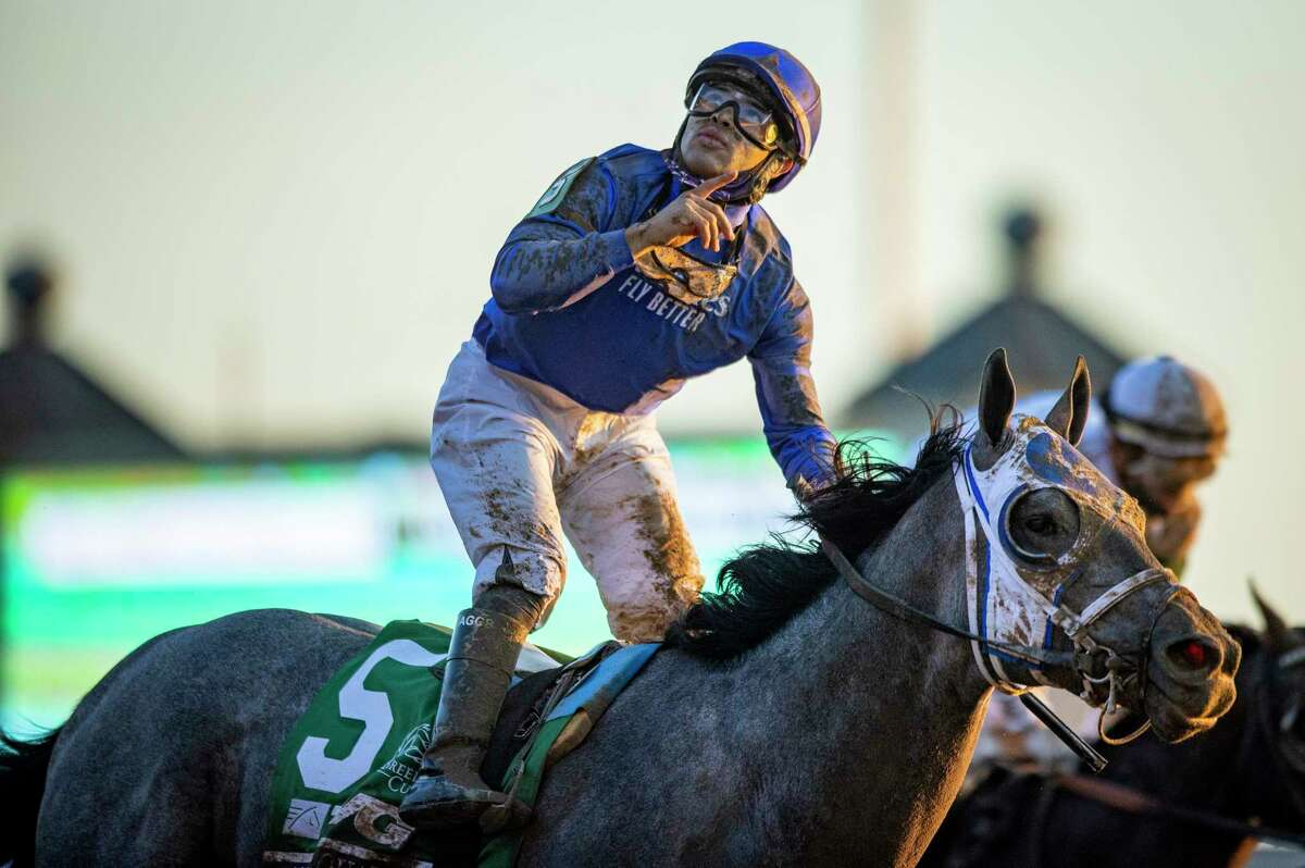 LEXINGTON, KY - NOVEMBER 07: Louis Saez, riding Essential Quality, celebrates after winning the Breeders Cup Juvenile at Keenland on November 6, 2020 in Lexington, Kentucky.
