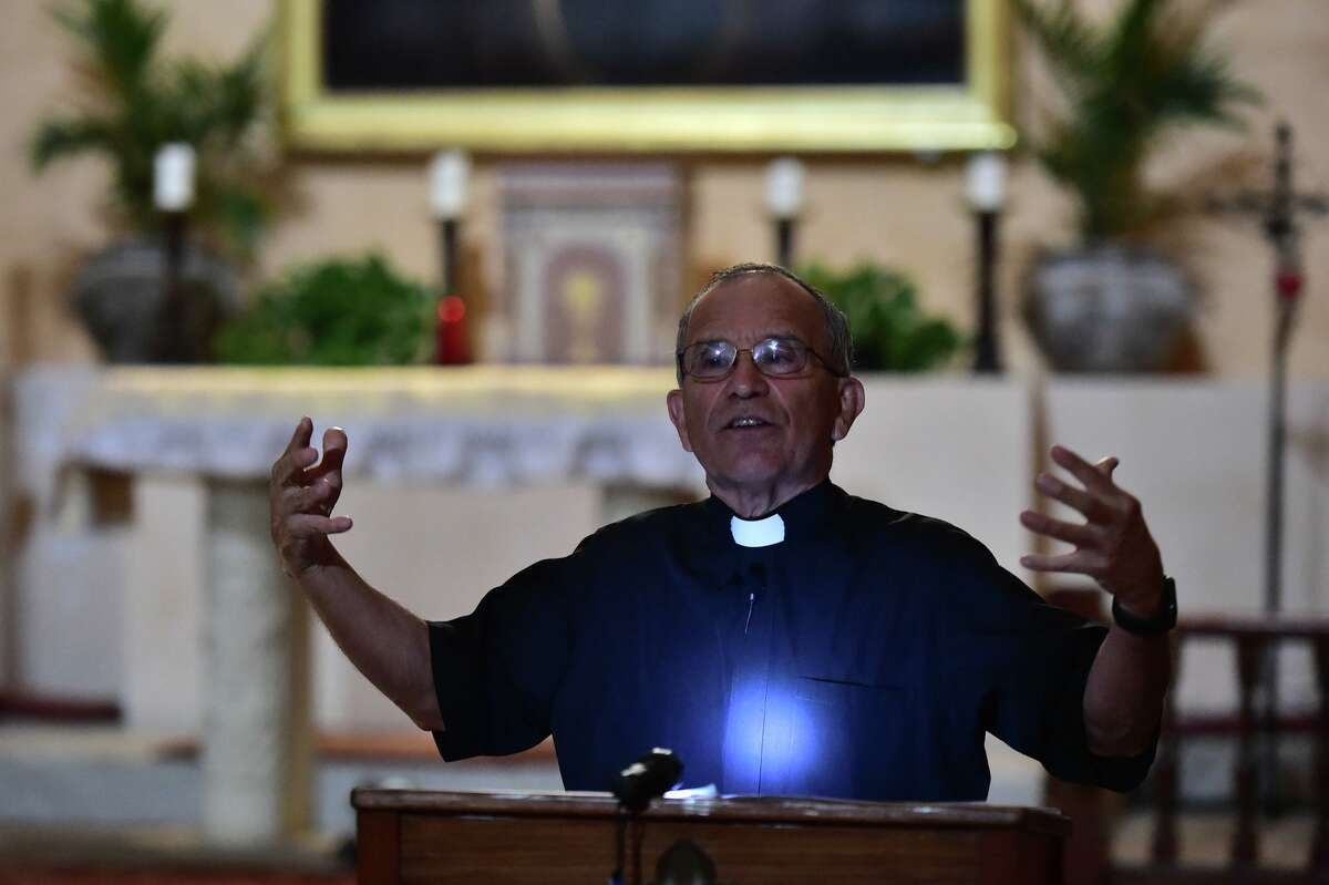 Father David Garcia speaks during a Double Solar Illumination at Mission Concepción.