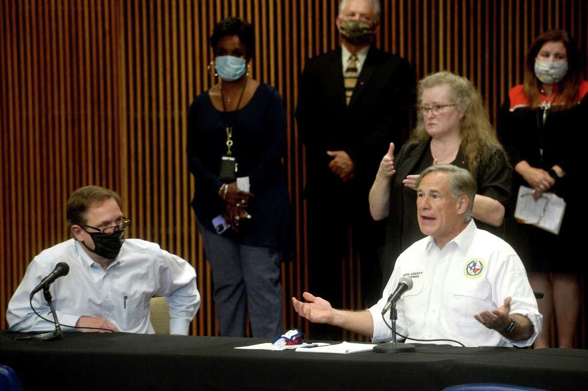 Judge Jeff Branick listens as Governor Greg Abbott speaks during a press conference with local officials at the Jefferson County Courthouse Tuesday to discuss the status of COVID-19 cases in the area, testing, and other issues. Photo taken Tuesday, August 11, 2020 Kim Brent/The Enterprise