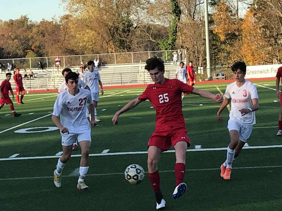 William Flynn of Greenwich, center, looks to get a touch on the ball during a boys soccer game between the Cardinals and New Canaan in the semifinals of the FCIAC West Region Tournament on Friday, Nov. 6, 2020, in Greenwich, Connecticut. Surrounding Flynn are New Canaan's Milan Afshar, left and Colin Mennitt. Photo: David Fierro / Hearst Connecticut Media