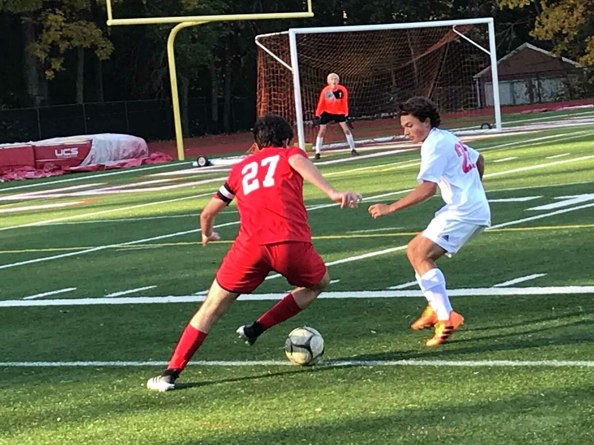 Matias Lew of Greenwich, left, looks to move the ball toward the goal during a boys soccer game between the Cardinals and New Canaan in the semifinals of the FCIAC West Region Tournament on Friday, Nov. 6, 2020, in Greenwich, Connecticut. Greenwich posted a 2-0 win.