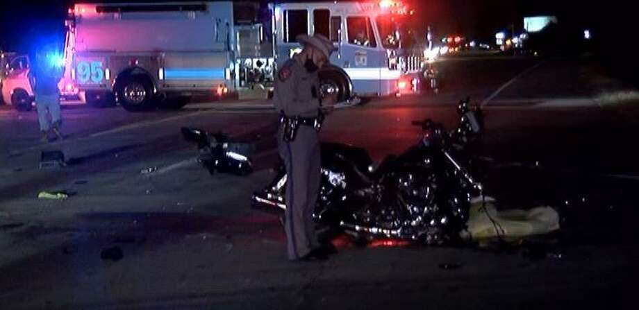 A Texas Department of Public Safety trooper stands over a motorcycle following a crash Nov. 4 on FM 1484 in Montgomery County where the motorcyclist died. Photo: Courtesy Of The Montgomery County Police Reporter