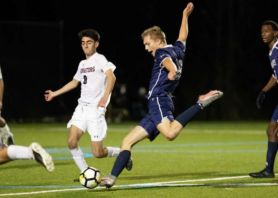 Wilton's Oliver Dahlen looks to take a shot while McMahon's Evangelos Mallios (8) defends in Friday night's FCIAC Central Region title game. Photo: Gretchen McMahon / For Hearst Connecticut Media / (C)GretchenMcMahonPhotography