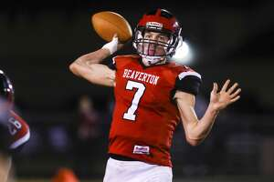 Beaverton's Trent Reed looks to throw the ball against the Oscoda defense Friday, Nov. 6, 2020 at Beaverton High School. (Cody Scanlan/for the Daily News).