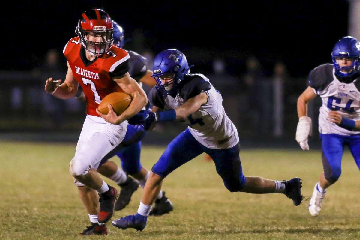 Beaverton's Trent Reed runs the ball up field against Oscoda Friday, Nov. 6, 2020 at Beaverton High School. (Cody Scanlan/for the Daily News).