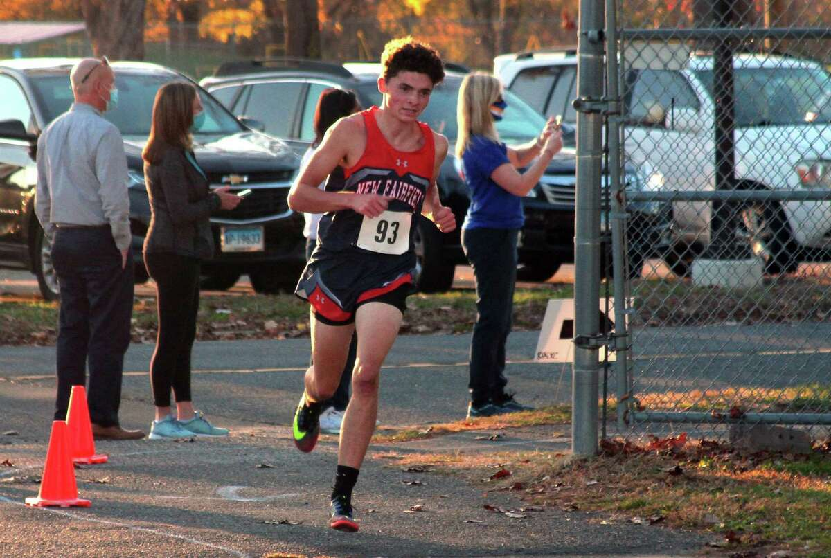 New Fairfield's Patrick Gibbons competes during SWC cross country action on Friday Nov. 6, 2020. Gibbons finished in first place.