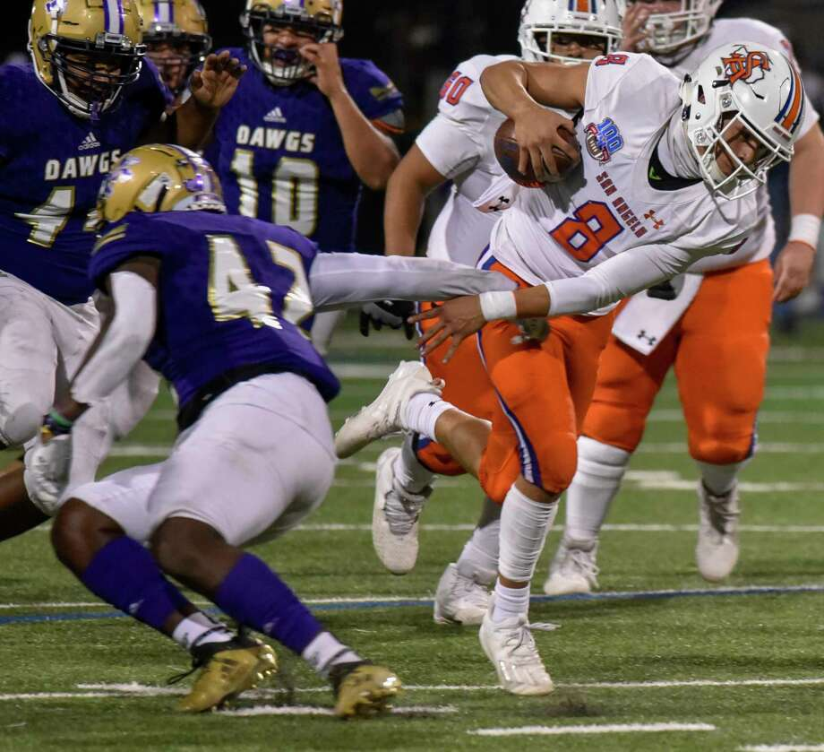 Midland High's Jordan Springer (42) trips up San Angelo Central's Malachi Brown (8) on Friday, Nov. 6, 2020 at Grande Communications Stadium. Jacy Lewis/Reporter-Telegram Photo: Jacy Lewis/Reporter-Telegram
