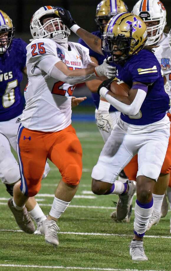 Midland High's Tecumseh Williams stiff arms San Angelo Central's Jacob OÕDell (25) on Friday, Nov. 6, 2020 at Grande Communications Stadium. Jacy Lewis/Reporter-Telegram Photo: Jacy Lewis/Reporter-Telegram